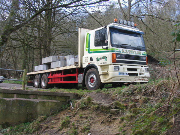 HGV load of twenty reinforced concrete beams of at least twenty tons