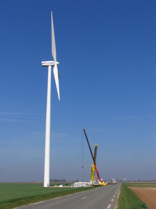 Winde turbines and tower cranes to service them
